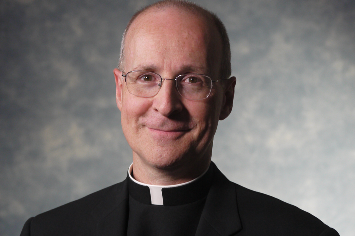Head shot of Father Martin dressed in clerical garb and smiling