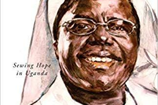Sister Rosemary smiling jovially in a white habit