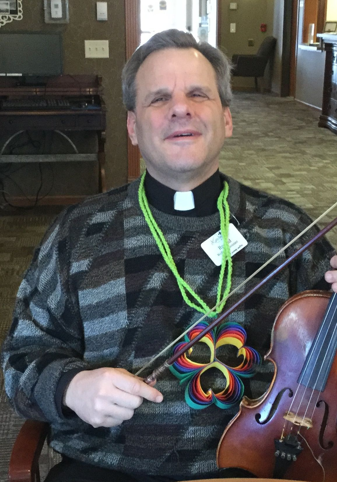 Father Ron pictured with a violin