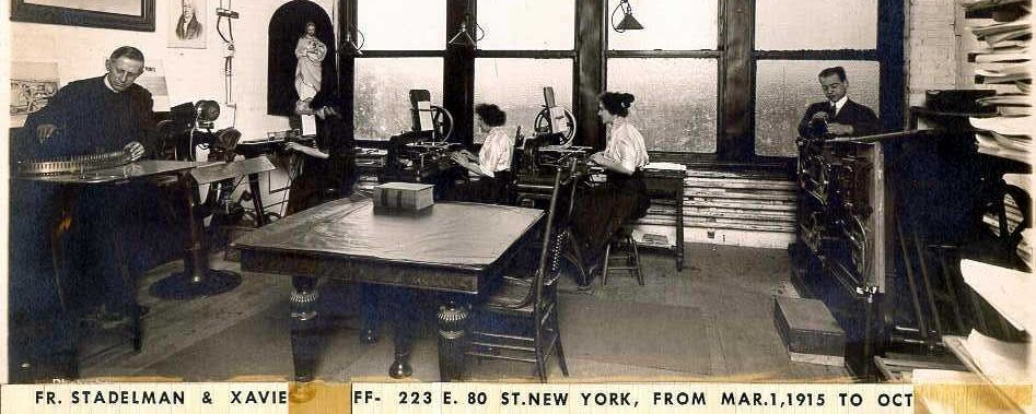 Picture of a room with four people working in it circa 1915
