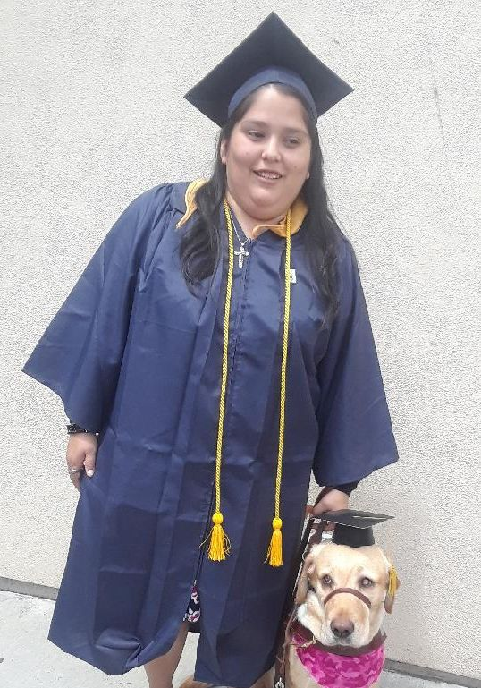 Valerie pictured with her guide dog at her graduation