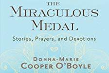 Cover of the book showing the miraculous medal against a blue and black back drop